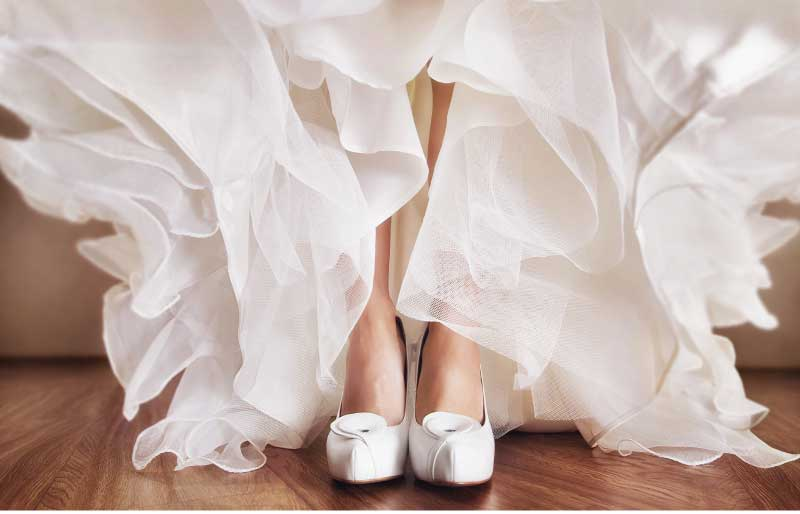 A bride wearing her wedding frock and shoes