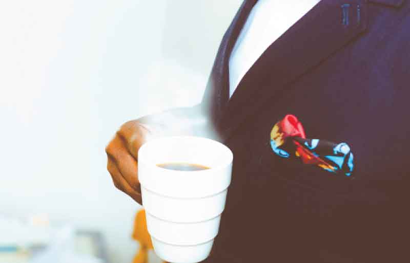 A gentleman during a meeting coffee break