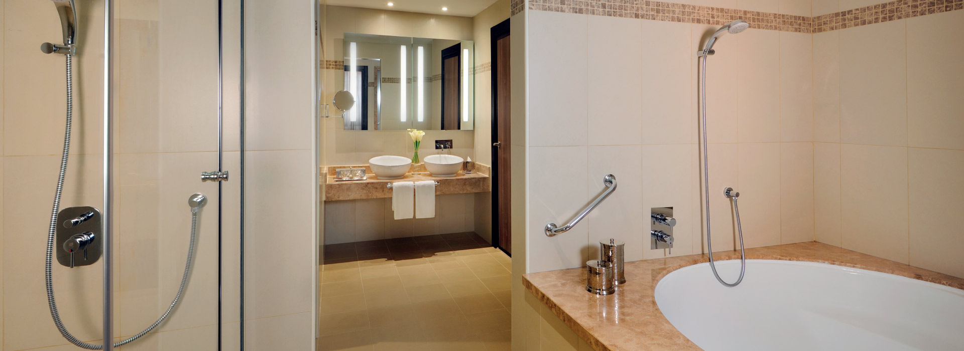 Interior of an executive suite bathroom at AVANI Deira Hotel