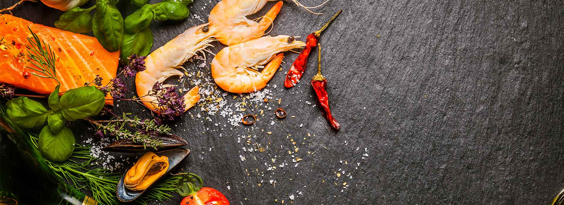 Shrimps and chilies on a chopping board