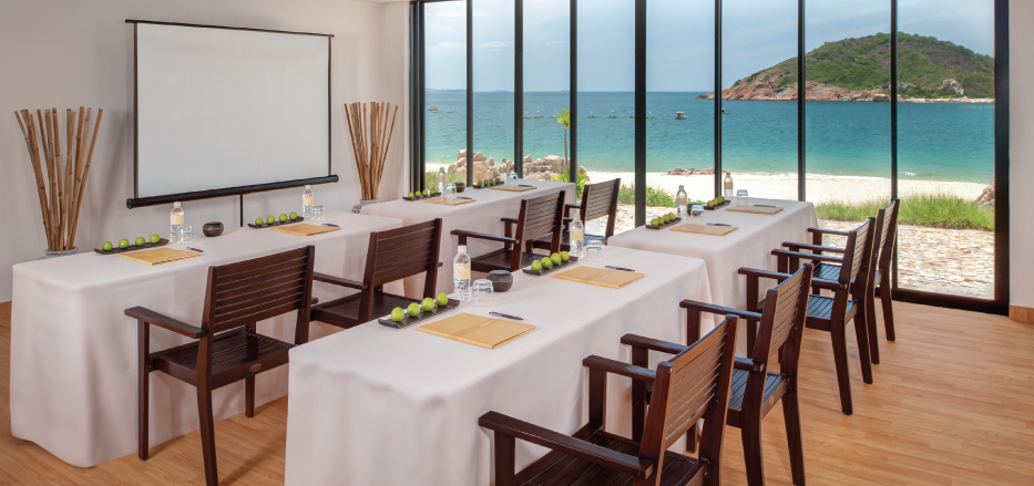 A meeting room with the sea view in background