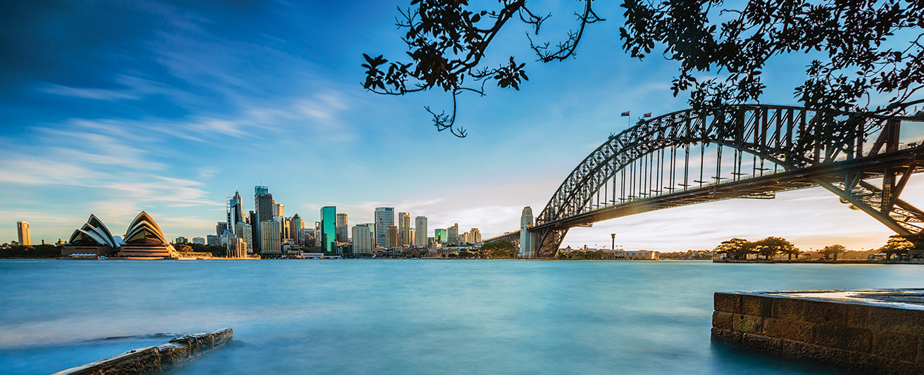 Australian hotels near Sydney Opera House and Harbour Bridge in the morning with blue skies