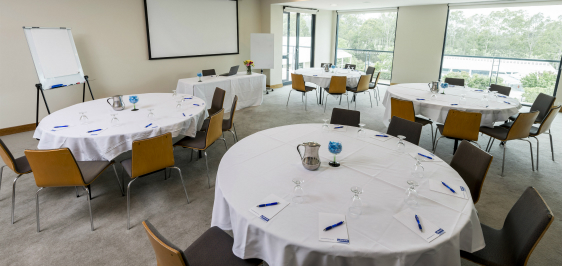 conference room in hunter valley with tables, chairs and whiteboard with plenty of sunlight