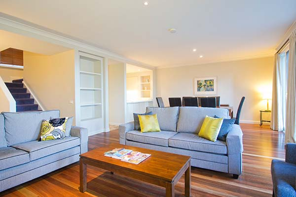 living room in hunter valley hotel with plenty of space for families and couples