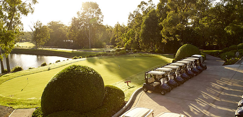putting green at sunset with golf buggies for hire at Hunter Valley resort golf course at Cypress Lakes