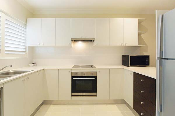 kitchen with full size fridge oven and microwave in air conditioned hotel apartment port stephens nsw