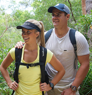 Couple bushwalking through Tomaree National Park New South Wales