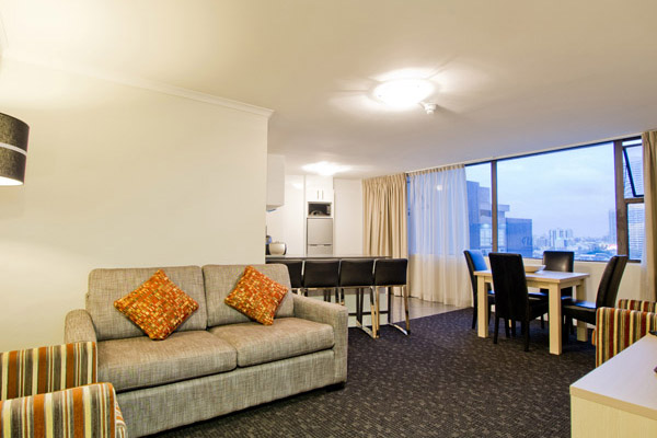 2 bed apartment living room at Oaks Hyde Park Plaza, Sydney CBD