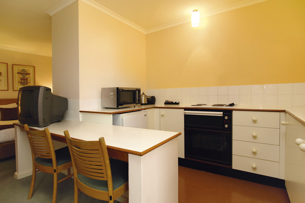 hotel kitchen with oven, stove top and microwave in Sydney city