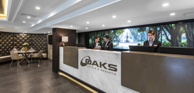 reception area and friendly hotel staff at oaks Hyde Park Plaza in Sydney CBD