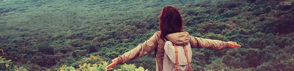 Traveler with Backpack looking at New South Wales bushland during summer