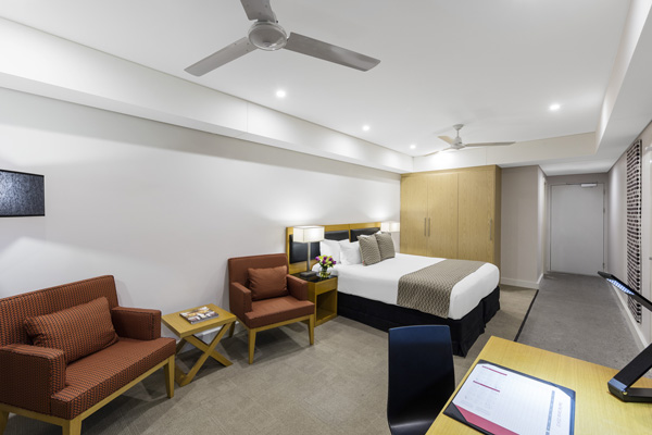 large living room with air conditioning and ceiling fan in 2 bed apartment in Darwin, NT Australia