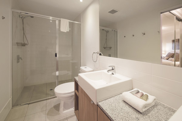 en suite bathroom with large shower and toilet in 1 bedroom executive hotel apartment in Brisbane city