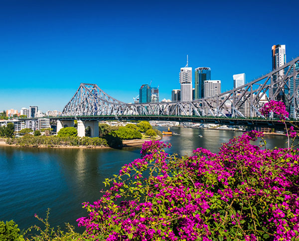 Brisbane hotels next to Story Bridge with Brisbane River and city with blue skies during summer in background