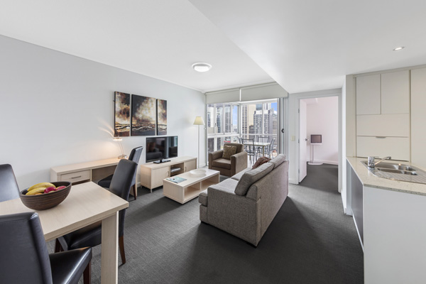 1 bedroom apartment. spacious hotel living room with comfortable furniture at Oaks Festival  Towers accommodation Brisbane CBD on Official Website Hotels in City