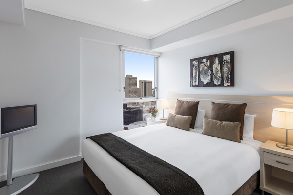 Best hotels in Brisbane city 2 bedroom apartment with queen size bed, television with Foxtel and views of Brisbane city at Oaks Festival Towers hotel