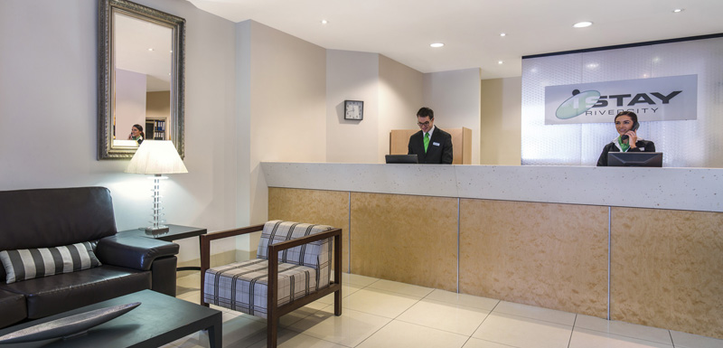 reception area with friendly hotel staff at iStay River City on 79 Albert St in Brisbane CBD