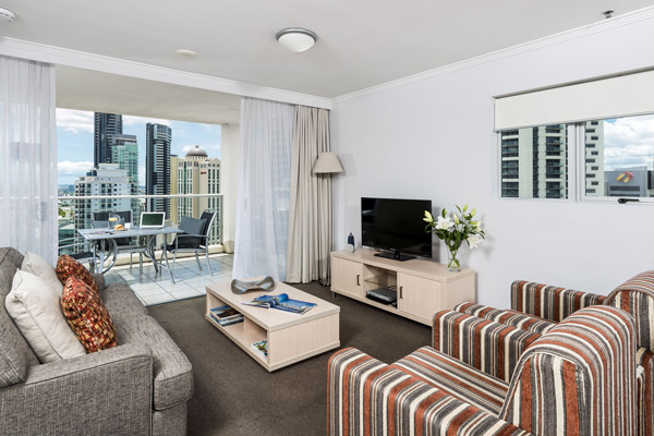 Brisbane CBD Hotels living room area with television and air conditioning at Oaks Lexicon Apartments on Ann St in Brisbane city