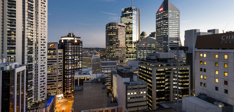 spectacular view of Brisbane city skyline at night from Oaks Lexicon Apartments hotel balcony