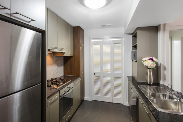 2 bedroom apartment kitchen with large fridge, oven, microwave and stove top near TAFE Bowen Hills