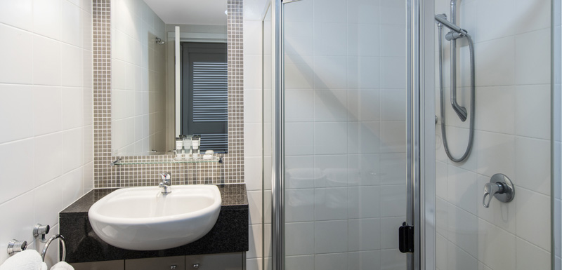 large shower and basin in 3 bedroom apartment en suite bathroom at Oaks Mews hotel in Bowen Hills, Brisbane