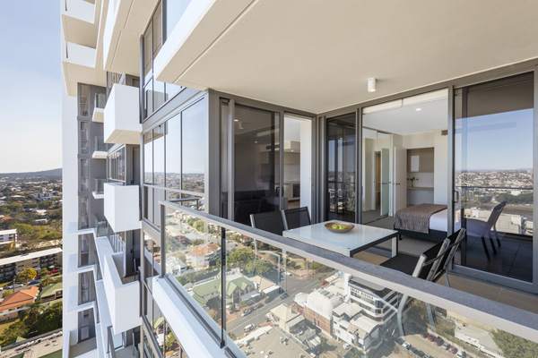 big balcony with furniture and views of Brisbane opposite Suncorp Stadium at The Milton hotel