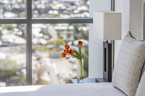 clean bed sheets in 1 bedroom apartment with views of Brisbane at The Milton hotel