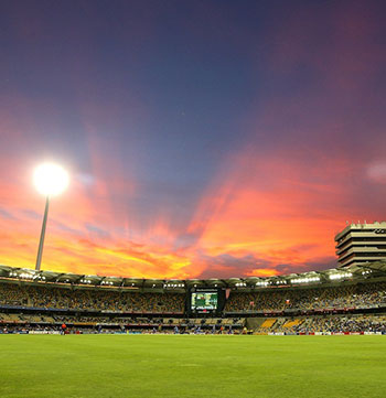 The Gabba cricket ground at sunset with floodlights in Woolloongabba, Brisbane, Queensland, Australia