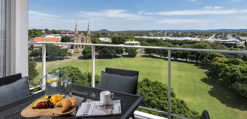 Oaks Aspire hotel 2 bedroom apartment balcony with views of park at hotels In Ipswich and cathedral in background