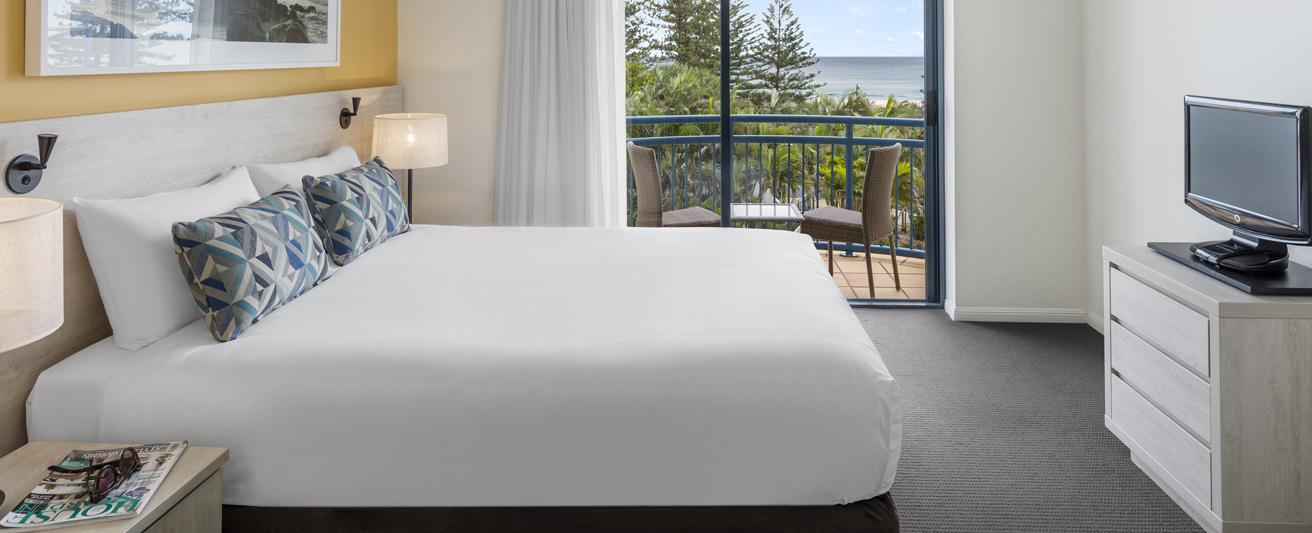 Coolangatta hotel with queen size bed in 1 bedroom apartment with balcony at Oaks Calypso Plaza hotel on Gold Coast, Queensland, Australia