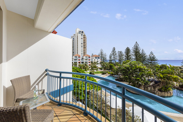 view from 1 bedroom apartment balcony of the ocean and swimming pool at Oaks Calypso Plaza hotel resort on Gold Coast, Australia
