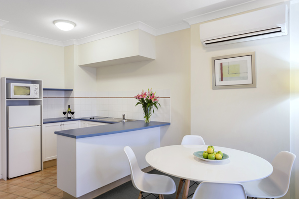 kitchen in 1 bedroom apartment with full-size refrigerator, microwave and toaster at Oaks Calypso Plaza resort in Coolangatta