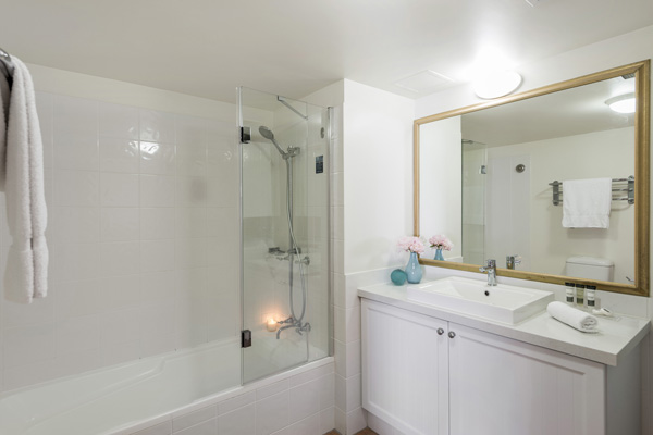 clean en suite bathroom in 1 bedroom apartment at Oaks Calypso Plaza hotel resort with shower and fresh towels
