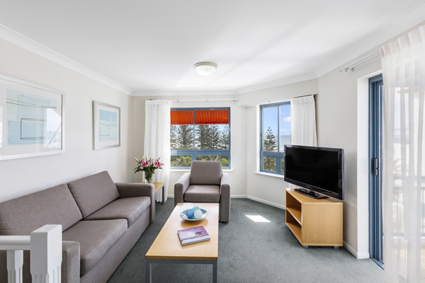 2 bedroom apartment living room with balcony walking distance to the beach at Oaks Calypso Plaza hotel resort, Coolangatta, Gold Coast, Australia