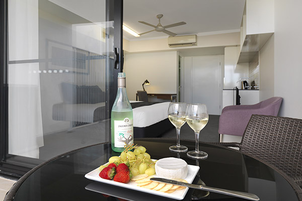 wine, cheese and biscuits on table on balcony of hotel room at Oaks Carlyle in Mackay, QLD