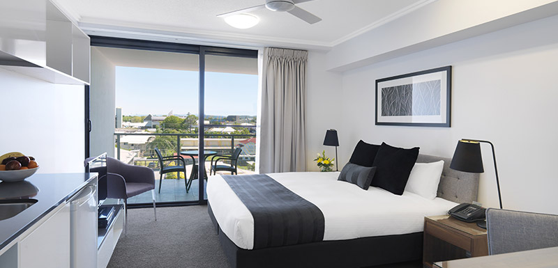 double bed with clean sheets in air conditioned hotel room at Oaks Carlyle in Mackay, Queensland