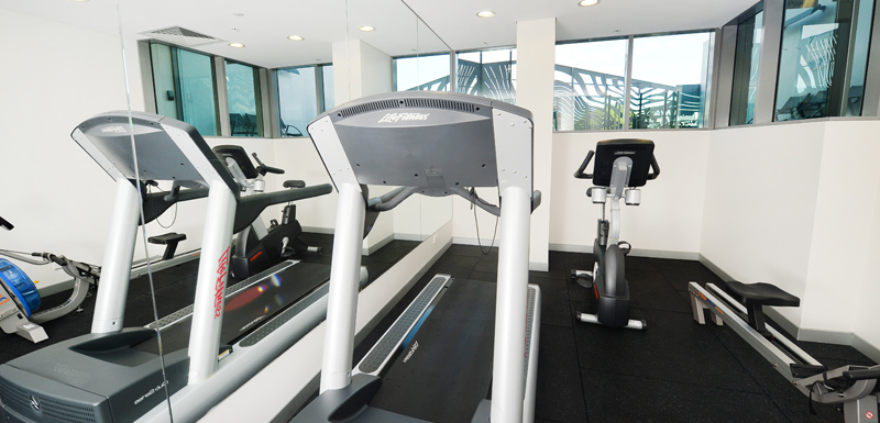 fully equipped gymnasium with treadmill, weights, cycling and rowing machine at Oaks Grand Gladstone hotel