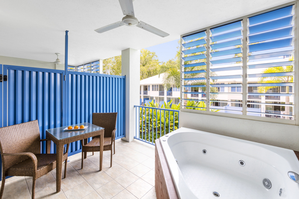 spa bath on balcony of 3 bedroom apartment at Oaks Lagoons hotel resort in Port Douglas