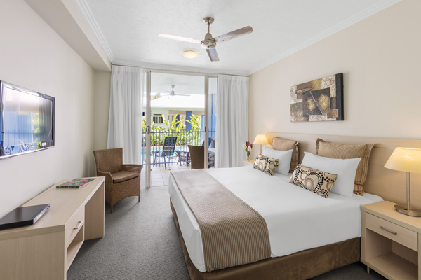 queen size bed in master bedroom of three bedroom hotel apartment with aircon in Port Douglas, Queensland, Australia