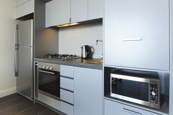 1 bedroom apartment kitchen with microwave and refrigerator near Suttons Beach in Redcliffe
