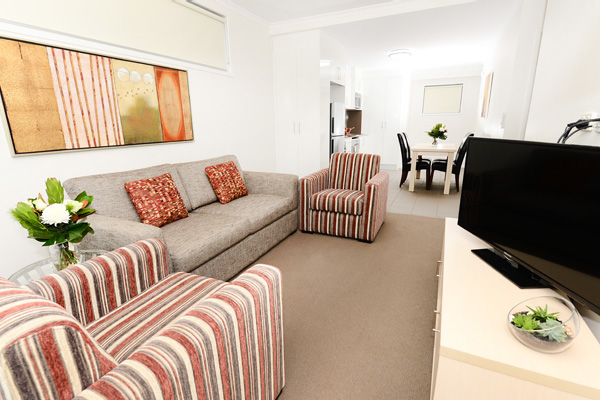 living room with TV and Foxtel in 2 bedroom apartment at Oaks Moranbah hotel in Queensland, Australia
