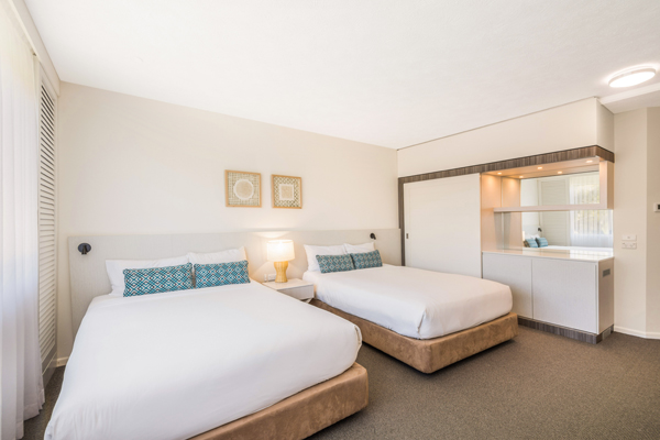 two queen size beds in bedroom with en suite bathroom in Executive Family hotel room at Oaks Oasis Resort in Caloundra on Sunshine Coast, Queensland, Australia