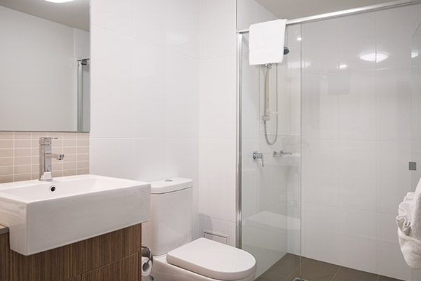 en suite bathroom with large, disabled access shower and toilet at Oaks Rivermarque hotel in Mackay, Queensland, Australia