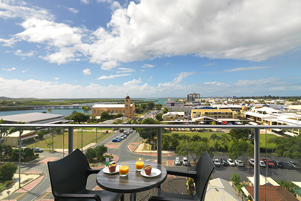 breakfast on table on private balcony of two bedroom executive apartment at Oaks Rivermarque hotel in Mackay, Queensland, Australia