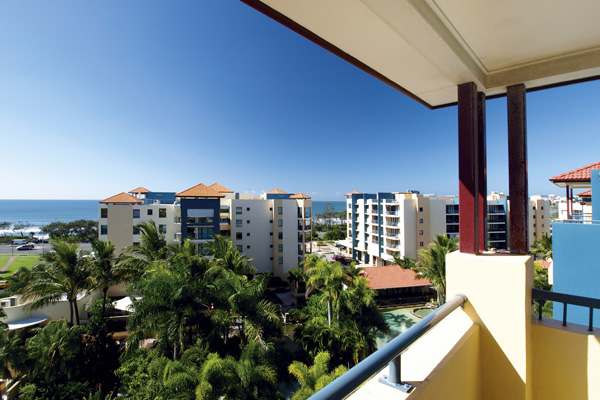 Sunshine Coast hotels with view of ocean, palm trees and Alexandra Headlands from large private balcony of 2 bedroom penthouse apartment at Oaks Seaforth Resort hotel on Sunshine Coast