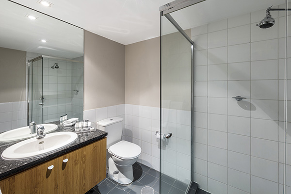 large en suite bathroom with shower and toilet at Oaks Embassy hotel Adelaide City, South Australia