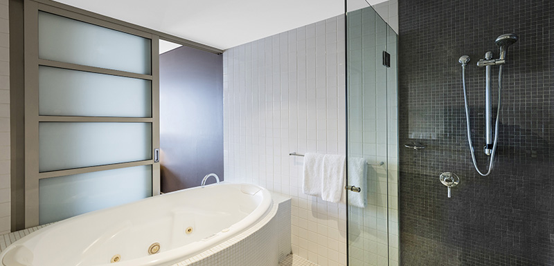 3 bedroom hotel apartment en suite bathroom with spa bath, jacuzzi, shower and toilet adjacent to bedroom