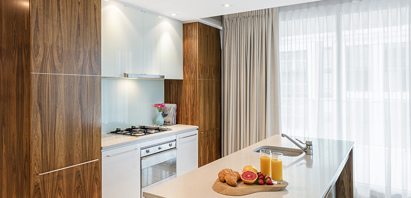 big kitchen with oven, microwave and fridge and large windows in background and healthy lunch on counter top in Adelaide CBD