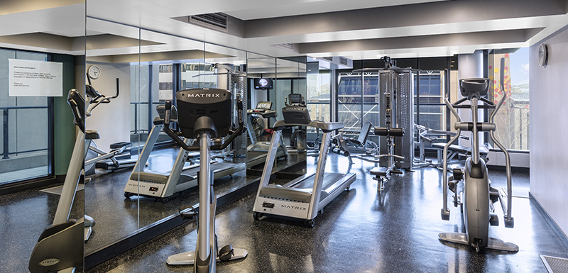 fully equipped gym at Oaks Embassy hotel with weights, treadmills, rowing machine and air conditioning