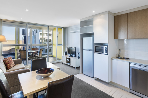kitchenette with microwave and fridge, freezer in open plan 2 bedroom apartment with private balcony near Adelaide Convention Centre with free Wi-Fi